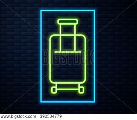 Glowing Neon Line Suitcase For Travel Icon Isolated On Brick Wall Background. Traveling Baggage Sign