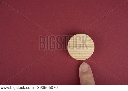 Blank Wooden Circle For Conceptual Sign On A Red