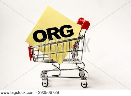 Shopping Cart And Text Org On Yellow Paper Note List. Shopping List, Business Concept On White Backg