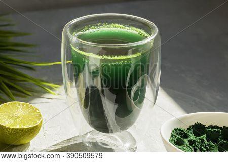 Spirulina Drink With Lime And Spirulina Algae Powder On White Plate. Superfood Detox Drink. Natural