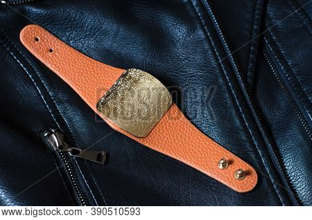 Stylish Female Brown Bracelet On A Black Jacket. Beautiful Female Bracelet Close Up