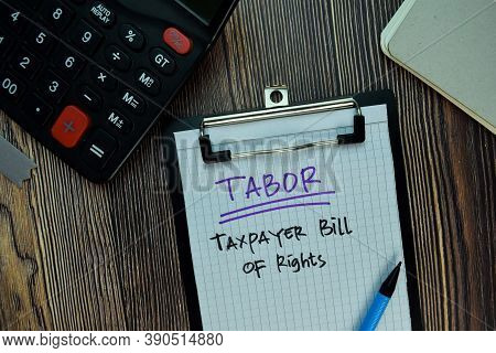 Tabor - Taxpayer Bill Of Rights Write On A Paperwork Isolated On Wooden Table. Business Or Financial