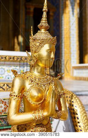 Statue Of A Kinnara In The Temple Of The Emerald Buddha, Wat Phra Kaew In Bangkok Thailand