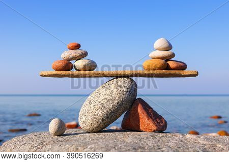 Symbolic Scale Of The Stones On Sea Background. Concept Of Harmony And Balance. Work-life, Emotional