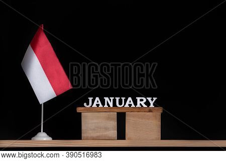 Wooden Calendar Of January With Polish Flag On Black Background. Holidays Of Poland In January