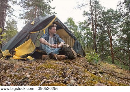 Mature Caucasian Man Sitting In Camping Near Tent After Walking