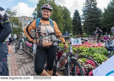 Cyclists Gathered For A Walk, Female Cyclist On Holiday, Russia, Kaliningrad Region , Chernyakhovsk