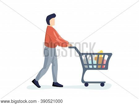 Young Man Purchaser Carrying Supermarket Shopping Cart Full Of Groceries. Male Buyer Pushing Grocery