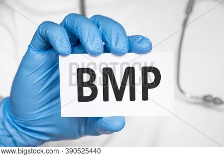 Doctor Holding A Card With Text Bmp Basic Metabolic Panel, Medical Concept