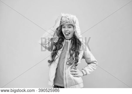 Winter Fashion Concept. Warm Hat For Cold Weather. Faux Fur Trend. Girl Long Curly Hair Wear Fur Hat