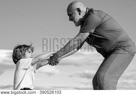 Father Or Grandrahter Criticizing His Disobedient Child For Bad Behavior. Cmauvais Ton. Hild-rearing