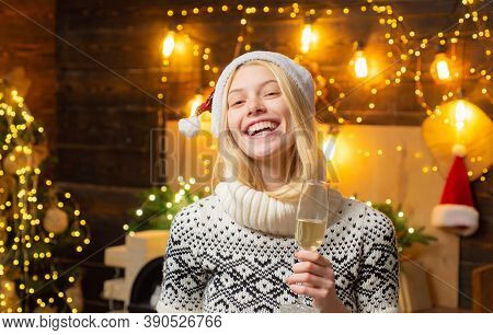 Christmas Woman. Portrait Of Optimistic And Charismatic Young Happy Young Blonde Smiling And Pointin