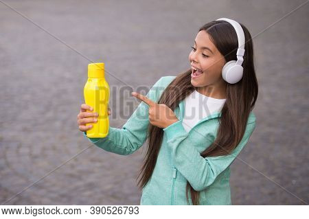 Happy Teenage Girl Pointing Finger On Water Bottle Going To Drink, Refreshment.
