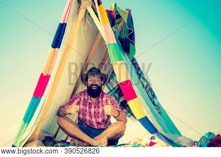 Camping. Homemade Tent Camping For Free Man. Travel Homemade Tent. Hut Of Branches. You Cant Buy Lov