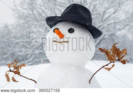 Snowman With Light Star In Christmas Day. Snow Man In Winter Hat. Funny Snowmen. Making Snowman And