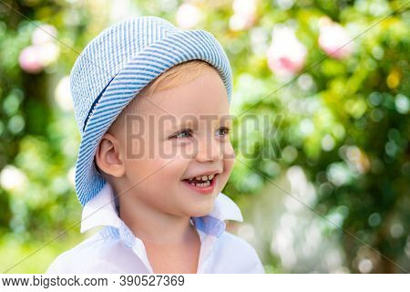 Happy Child Portrait. Adorable Baby Having Fun. Beautiful Fun Day For Cute Little Boy In Nature. Hap
