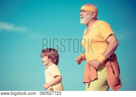 Grandpa And Child Sportsmen Jogging Outdoors And Enjoying Sunny Day. Like Sports. Funny Sporty Old S