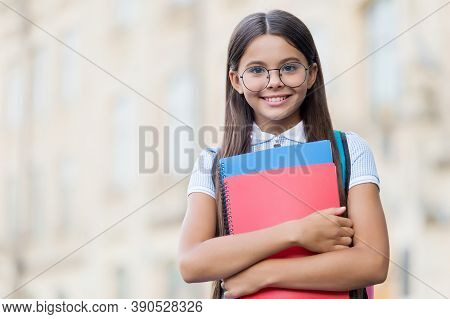 Happy Small Kid Smile In Eyeglasses Holding School Books Outdoors, Knowledge, Copy Space.