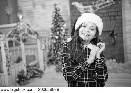 Christmas Tree Decorations Interior Background. Small Girl At Home Garland Lights. Turn On Garland F