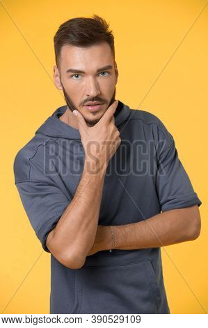 Bearded Man Touch Beard With Hand. Man With Bearded Face. Bearded Man With Unshaven Face. Bearded An