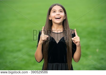 Inspired Happy Girl With Long Hair In Fashion Dress Look Up Keeping Indeex Fingers Raised Green Gras