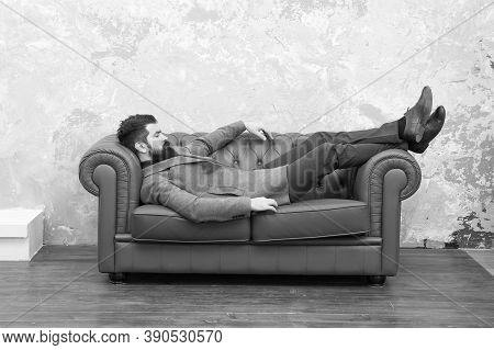 Dropped Into Sleep. Bearded Man Take Nap On Sofa. Hipster Sleep Wearing Clothes And Shoes. Nap Or Da