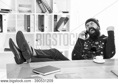 Spreading Holiday Cheer. Businessman In Christmas Jumper. Hipster Talk On Mobile Phone. Bearded Man