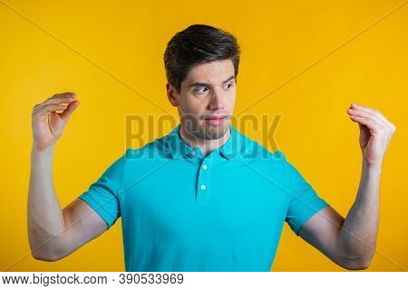 Handsome Bored Man Showing Bla-bla-bla Gesture With Hands And Rolling Eyes Isolated On Yellow Backgr
