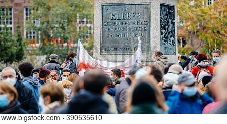 Strasbourg, France - Oct19, 2020: Group Of French People In Place Kleber To Pay Tribute To History T