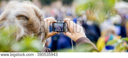 Strasbourg, France - Oct19, 2020: Woman Taking Photos Place Kleber To Pay Tribute To History Teacher