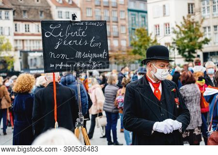Strasbourg, France - Oct19, 2020: Man Dressed As Old Teacher With Placard In Place Kleber To Pay Tri