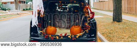 Trick Or Trunk. Black Car Trunk Decorated For Halloween. Autumn Fall Decor With Red Pumpkins And Yel
