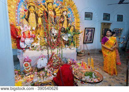 Kolkata, West Bengal, India - 6th October 2019 : Hindu Purohit Uttering Sanskrit Shlokas For Puja Wh