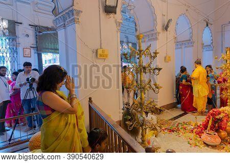 Kolkata, West Bengal, India - 6th October 2019 : Hindu Female Devotee Praying To Goddess Durga With