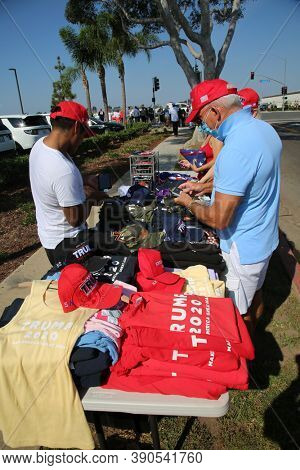 Irvine, California / USA - October 18.2020: Vendors Sell President Donald J. Trump Flags, Hats, Signs and Memorabilia at a Presidential Fundraiser. Editorial Use Only.