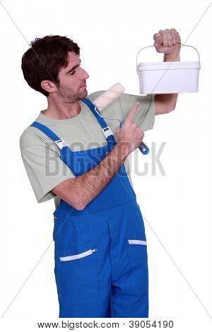 house painter showing a paint pot