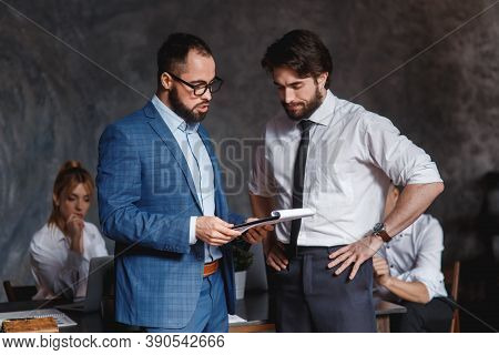 Caucasian Colleagues Disputing Having Disagreement At Work Blaming Each Other In Mistake, Diverse Co