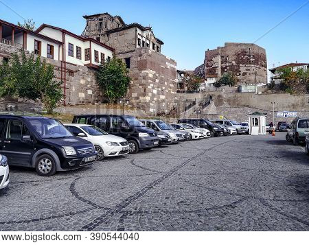 Turkey, Ankara - October 23, 2019: Parking With Many Modern Cars In The Background Of The Ancient Wa
