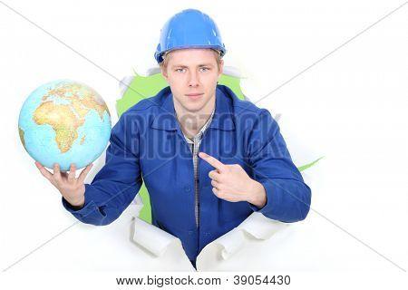 Man pointing at globe