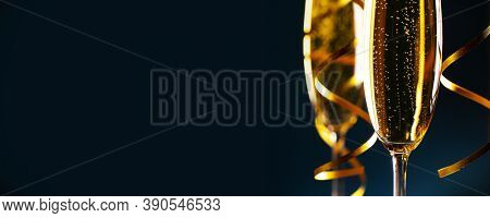 Two glasses of champagne on dark blue background New Year party celebration concept