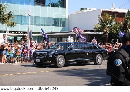 Newport Beach, California / USA - October 18.2020: President Donald J. Trump Waves the his fans from his Limo as he leaves a Fundraiser in Newport Beach. Editorial Use Only.