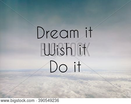 Motivational And Inspirational Quote Of Dream It Wish It Do It With Sky And Clouds Background. Stock