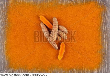 Turmeric Root And Curcuma Spice Background. Anti-inflammatory Herbal Medicine, Nutrional Supplement.