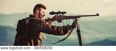 Hunting Period. Male With A Gun. Hunter With Hunting Gun And Hunting Form To Hunt. Hunter Is Aiming.