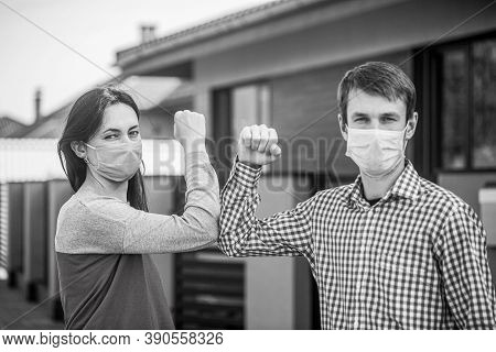 Elbow Bump. Couple Greeting With Elbows. Elbows Bump. Friends In Protective Medical Mask On His Face