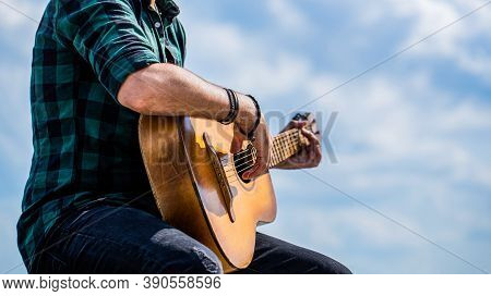 Guitars Acoustic. Male Musician Playing Guitar, Music Instrument. Mans Hands Playing Acoustic Guitar