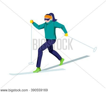 Young Woman Skiing At Ski Resort. Girl Skier On Warm Winter Clothing Riding On Snow Slope. Winter Sp