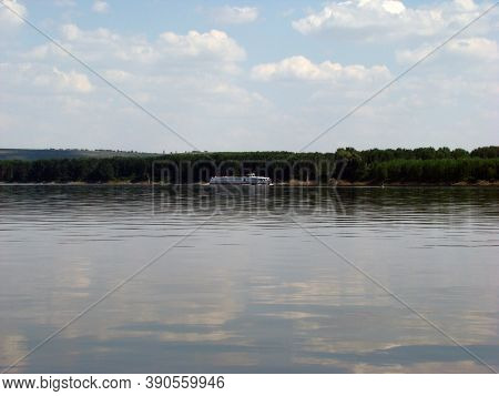 Downstream Danube River Downstream Cruise Ship With Tourists Interested In The Natural Beauties Of T