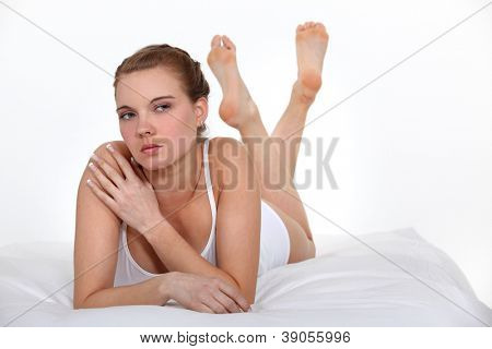 serious beautiful woman on bed