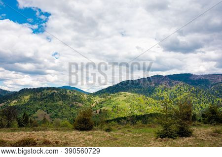 Mountain Landscape In Spring. Cloudy Sky. Beautiful Countryside